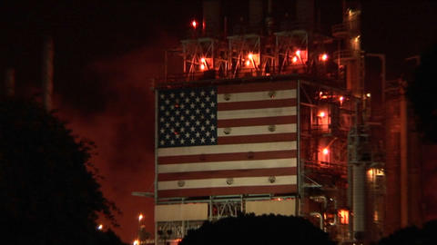 An American flag mural decorates the side of an oil... Stock Video Footage
