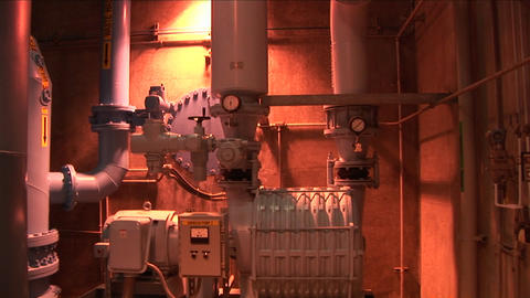 A pump runs inside of a water treatment facility Stock Video Footage