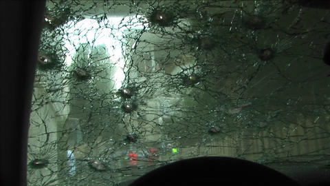 A windshield is shattered by bullets after an... Stock Video Footage