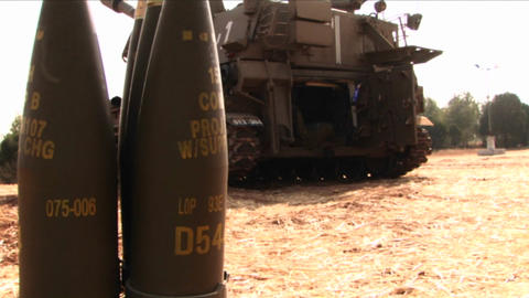 Artillery shells stand behind a tank in Israel Stock Video Footage