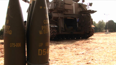 Artillery shells stand behind a tank in Israel Footage