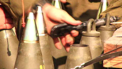 Israeli soldiers prepare and test shells during the war... Stock Video Footage