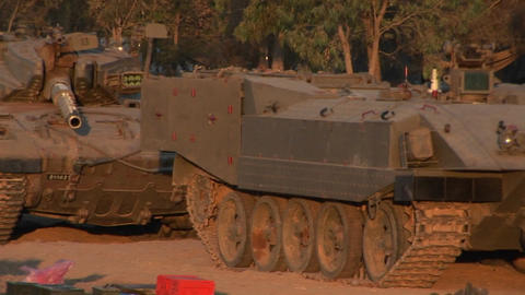 Israeli armored vehicles sit parked in the desert Stock Video Footage