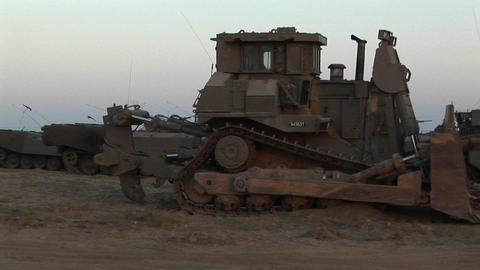 Armored vehicles wait at an Israeli army staging post at... Stock Video Footage