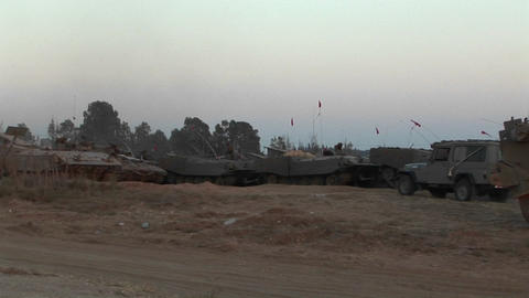 Armored vehicles wait at an Israeli army staging post at the Gaza strip border Footage