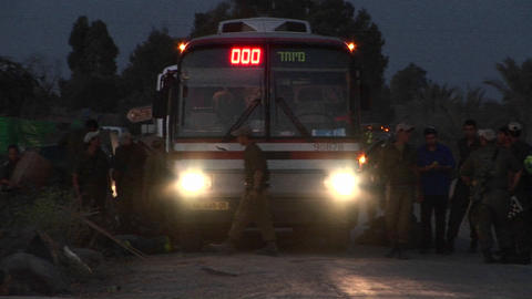 Israeli soldiers stand around a transport bus in a border... Stock Video Footage