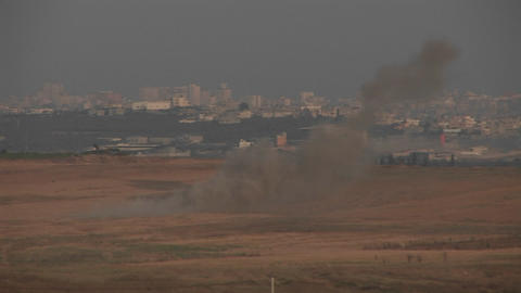 Smoke rises in the distance between Israel and the Gaza... Stock Video Footage
