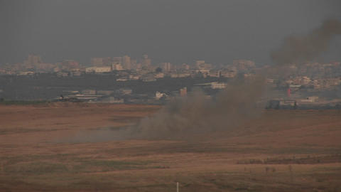 Smoke rises in the distance between Israel and the Gaza Strip Footage