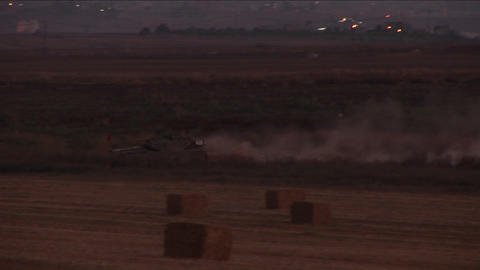 An Israeli tank moves through a no man's land on the border of Israel and the Gaza Strip Footage