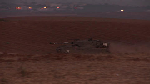 An Israeli tank moves through a no man's land on the... Stock Video Footage
