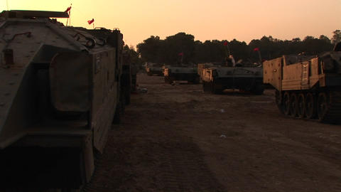 A line of Israeli army vehicles are parked along the... Stock Video Footage