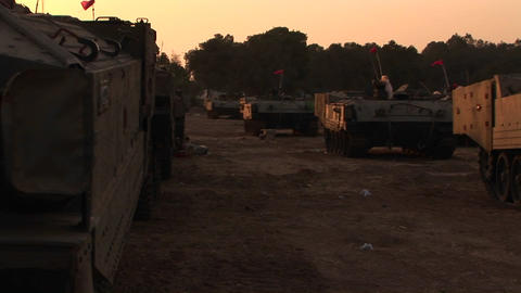 A line of Israeli army vehicles are parked along the Israel - Gaza Strip border Footage