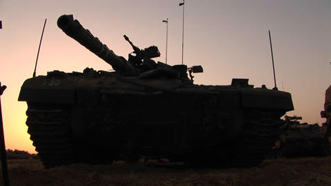 An Israeli army tank is parked on the border of the Gaza... Stock Video Footage