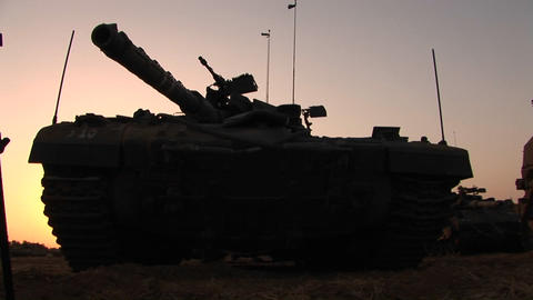 An Israeli army tank is parked on the border of the Gaza strip Footage