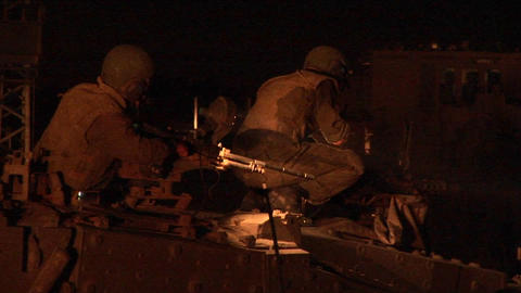 An Israeli soldier works on a machine gun during a... Stock Video Footage