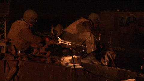 An Israeli soldier works on a machine gun during a wartime operation Footage