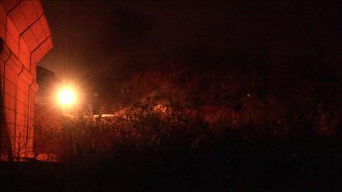 An Israeli army tank patrols along the border wall at night Stock Video Footage