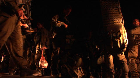 Israeli soldiers with guns mill about during a night patrol Stock Video Footage