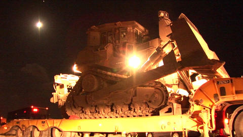 An Israeli armored bulldozer is unloaded from a flatbed... Stock Video Footage