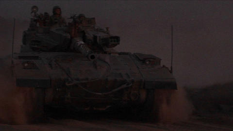An Israeli tank passes at high speed during an early... Stock Video Footage