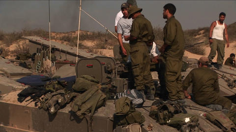 Off duty Israeli soldiers stand on top of a tank during a... Stock Video Footage