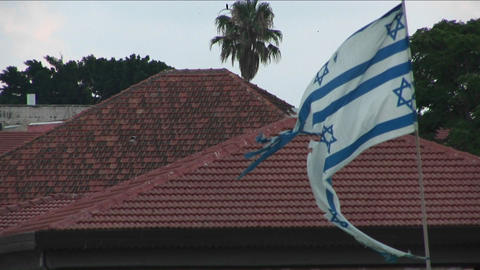 A tattered Israeli flag flies during the war with Lebanon Stock Video Footage