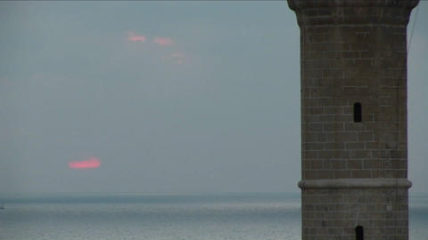 The sun sinks behind the minaret of a mosque in Israel Footage