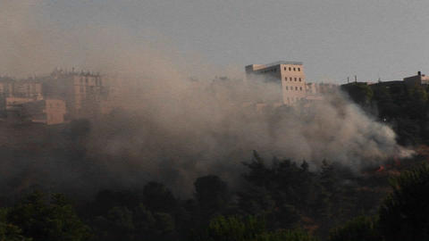 Smoke rises from a rocket attack in Northern Israel... Stock Video Footage