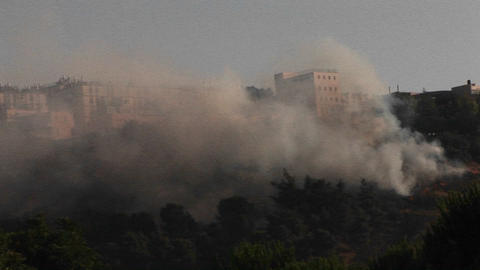 Smoke rises from a rocket attack in Northern Israel during the Israel Lebanon war Footage
