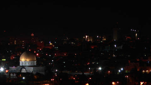 The Dome of the Rock, in Jerusalem, is illuminated by city lights Footage