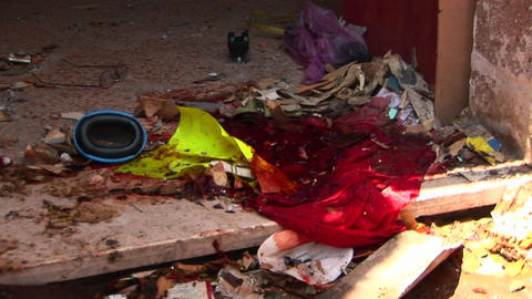Blood soaked debris lies on the ground after a suicide... Stock Video Footage