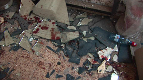 Blood and broken glass litter the site of a suicide... Stock Video Footage