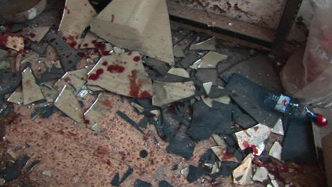 Blood and broken glass litter the site of a suicide bombing in the Middle East Footage