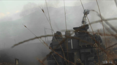 An Israeli army tank fire shells into Lebanon during the... Stock Video Footage