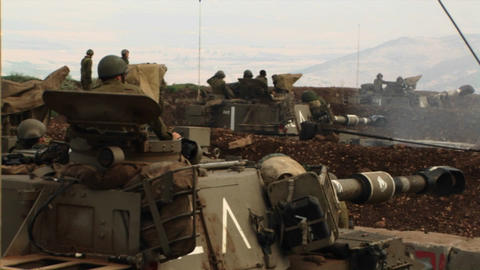 Israeli soldiers peer out of a tank during the Israel -... Stock Video Footage