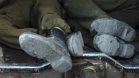 Israeli army officers get some rest in the back of a tank... Stock Video Footage