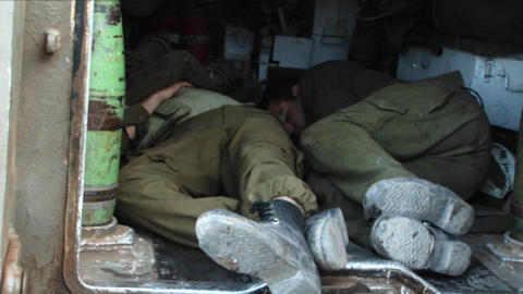 Israeli army officers get some rest in the back of a tank during the Israel - Lebanon war Footage