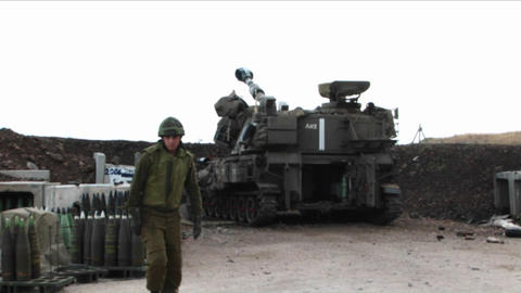 An Israeli army tank fires shells across the border in... Stock Video Footage