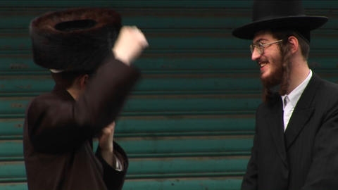 Orthodox Jews talk in the street in Haifa, Israel Stock Video Footage