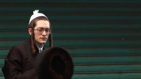 Orthodox Jews talk in the street in Haifa, Israel Stock Video Footage