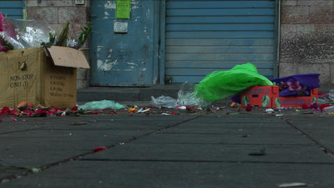 Trash and garbage line an urban city street Footage