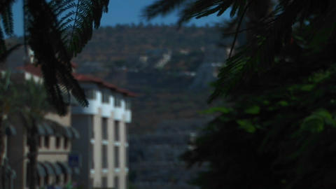 An apartment building and hillside are visible through... Stock Video Footage
