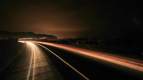 Time lapse of a freeway at day and night Stock Video Footage