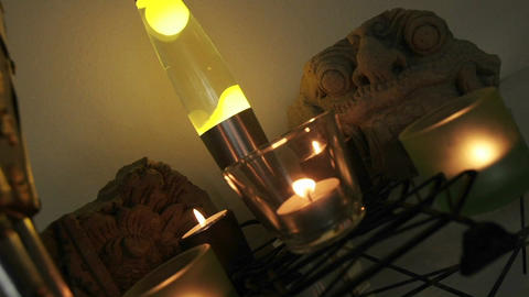 Time lapse of a lava lamp and candles in a living room Stock Video Footage