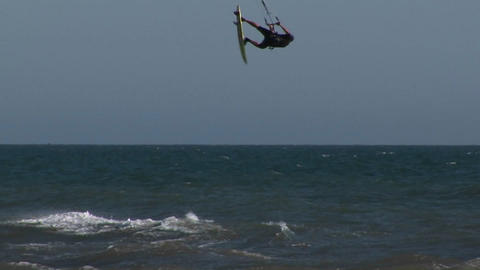 A kitesurfer catches air from a wave Stock Video Footage