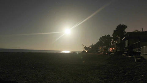 Time lapse of the sun setting at a beach Stock Video Footage