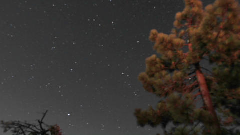 Time lapse from night to day of stars moving across the... Stock Video Footage