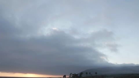 Time lapse of dark clouds and the sun setting Stock Video Footage
