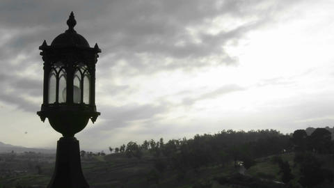 Time lapse of clouds over a street lamp and forest Stock Video Footage