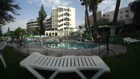 Time lapse of guests at a hotel pool Stock Video Footage